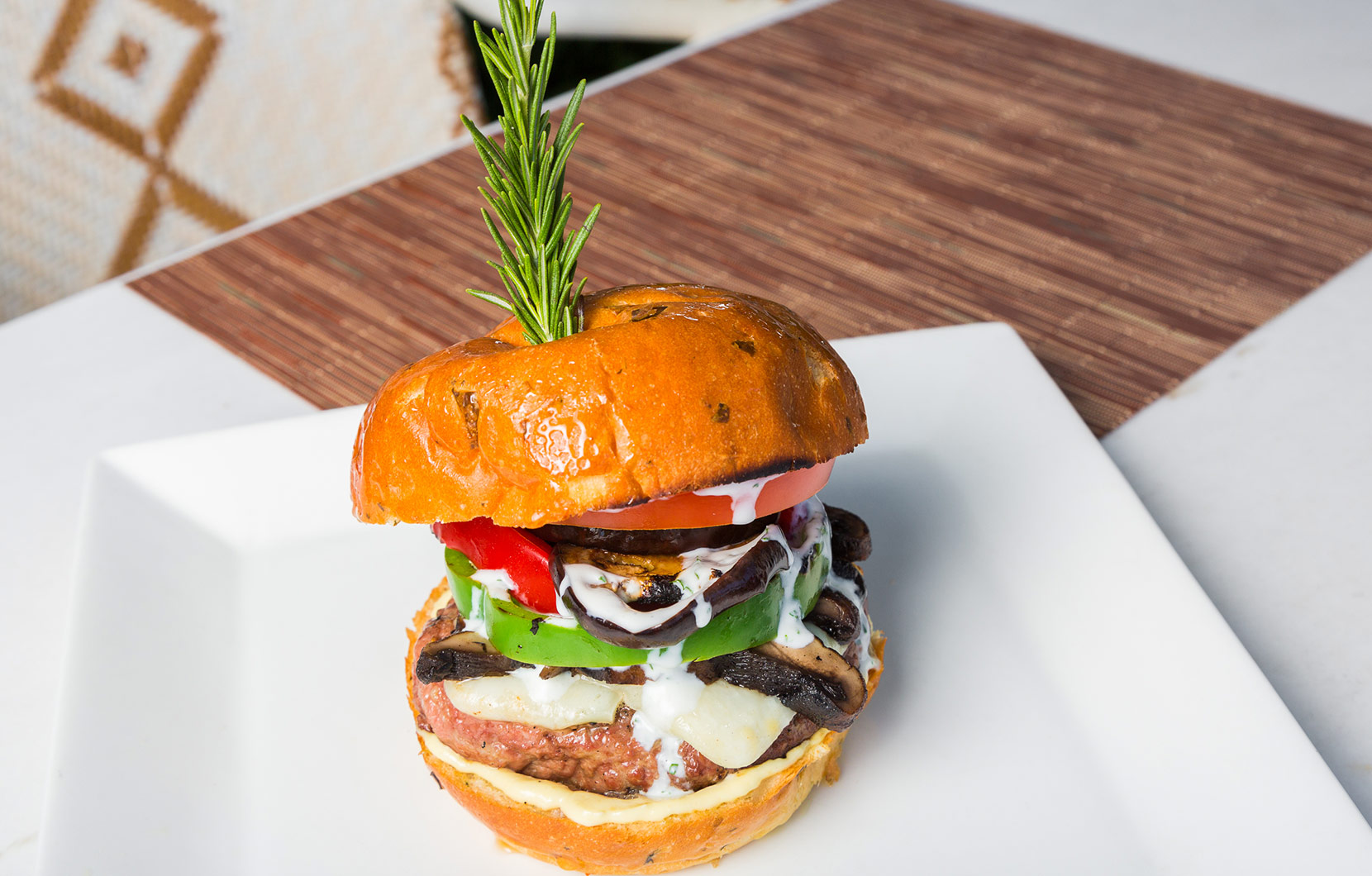 This robust lamb burger by Chef Raúl puts a Mediterranean spin on the mainstay.