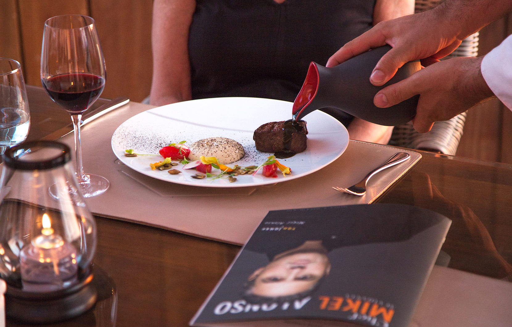 A diner enjoys the 8-course menu prepared by Chef Alonso at Quinto.